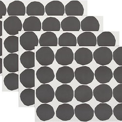 Marimekko Kivet Black and White Paper Placemats - Your guests won't mind that you didn't pull out the linen tablecloth when they see these lovely black and white paper placemats.