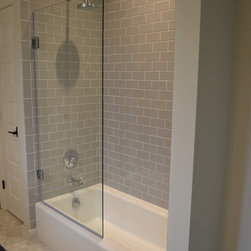 Shower/Tub - Tub Surround with Frameless Glass Door