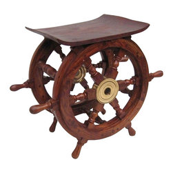 Handcrafted Nautical Decor - Wood and Brass Ship Wheel Table 18'' - The    Hampton Nautical Wooden Ship's Wheel Table 18'' is by far  the  highest quality nautical table available.  Made from rare, high  quality  Shisham wood imported  from India, a hardwood similar to teak  that is  highly regarded for its  ability to resist foul weather and the   elements. The ship wheel has six  spokes, each skillfully turned and   assembled with plugged screw heads.  The solid brass center hubs have a   standard one-inch diameter hole and  machined keyways.--Any of our ship wheels will help turn any room, cabin, deck, patio or garden into your own nautical wonderland. --Dimensions: 18'' L x 9'' W x 12'' H------ ----    Handcrafted from solid Shisham wood with a solid brass center--    Weather resistant - indoor and outdoor use--    Heavy, sturdy and durable table--    --    Practical and fun accent----
