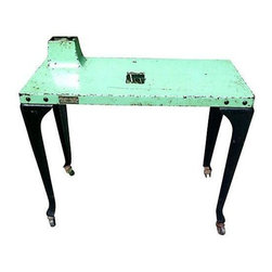 """Used 1950s Westinghouse Industrial Console Table - This 1950s Westinghouse teal and black factory table is the epitome of industrial chic! This incredible Americana piece rolls on casters, and at one time included a built-in lamp (the switch remains). It has metal tags with the Westinghouse logo and is 25"""" tall (30"""" including the raised lamp setting). A conversation starter if ever there was one!"""