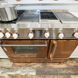"48"" BlueStar Range in Infused Copper - Showcasing a 48 Inch BlueStar Gas Range in Infused Copper from our Precious Metals Collection featuring a griddle, charbroiler, frenchtop, and 2 burners with beautiful white knobs"