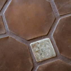 Modello Collection - The Dulzura Accent is nestled between octagon terra-cotta pavers enhancing the olde world feel.