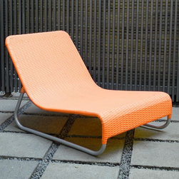 Sunny Modern Outdoor Wicker Lounge Chairs at HomeInfatuation.com. - This is a great chair for poolside, lakeside, beachside or just about anywhere. It's minimalist, practical, and comes in some great colors.