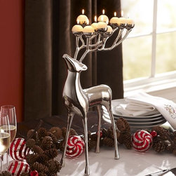 Silver-Plated Reindeer Candelabra - Reindeers are always welcome during the holidays, so why not put one to use? Not only does this silver sculpture add an elegant flair, but it also provides a touch of soft lighting.