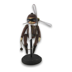 Zeckos - Bethany Lowe Steampunk Aviator Figurine 11 In. - This fantastic steampunk inspired aviator figurine, by Robin Seeber for Bethany Lowe Designs, brings elements of whimsy and imagination to your private collection. It is made of cast resin and carefully hand painted in extraordinary detail, and looks just like it's made of cloth. Gears and rivets adorn her flight suit, and there is even a propeller atop her hat. This masked aviator is mounted on a stand and looks like she is already in flight being lifted away by the propeller she carries in her hands. Her arms and legs are moveable pieces. This figurine stands 11 inches tall, is 4 1/4 inches wide, 4 inches deep, and mounted on a 5 inch diameter base. The propeller measures 7 1/2 inches in diameter and 6 inches long. The perfect Halloween piece or to enhance your shelf, bookcase or desk, and makes an excellent gift for steampunk enthusiasts.
