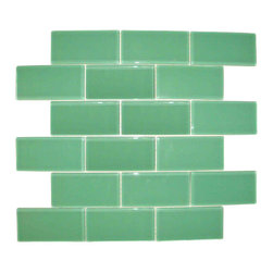 "Spa Glass - Light Blue 2X4 Subway Glass Tile, Light Blue, 2x4, Carton - CARTON of Light Blue 2X4 subway glass tile consisting of 20 square feet or sheets. This tile is manufactured in a thinner 1/8 inch thick format and is a high quality ""POOL RATED"" glass subway tile that is perfect for a kitchen backsplash, bathroom tile, shower tile or pool tile. Because the tiles are thinner and come mesh mounted in a staggered interlocking brick pattern, installation is much easier and much less expensive. The thinner profile eliminates the need for tear outs or large demolitions. You can tile over existing materials and eliminate installation cost ( think DIY).These are a very high grade glass subway tile kilned at 800 Celsius for maximum durability and come with a baked polypropylene backing which reflects the color back thru a very clear glass.  The tiles come in a 12X12 inch sheet consisting of 18 tiles 2X4 inches in size.  They come in boxes of 20 square feet or 20 sheets. There is also a SAMPLE option so you can confirm the color is perfect for your space. The Price listed is for a single CARTON OF 20 SQUARE FEET."