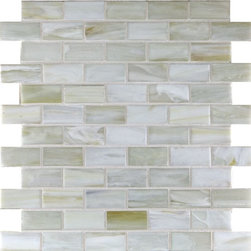 "Glass Tile Oasis - Smoke 1"" x 2"" Grey Pool Frosted Glass - Sheet size:  1.02 Sq. Ft.        Tile Size:  1"" x 2""        Tiles per sheet:  66        Tile thickness:  1/4""        Grout Joints:  1/8""        Recycled Components:  70%        Sheet Mount:  Paper Face     Sold by the sheet    -  This collection is evocative of the glass-like natural layered silica created by volcanic stone formations. With a nod to old world Venetian glassmakers  our mosaics are created using the same processes from molten silica; hand-poured  blending transparent and opaque colors and natural and opalescent finishes into a unique  luxurious glass designed to please the most discriminating eye. It is available in 14 dramatic color blends and two finishes  Glossy & Frosted. Each piece is hand-poured and unique  designed with a certain amount of variation and variegation of color  tone  texture and shade for a distinctive appearance. Our hand-made process incorporates creases  wrinkles  waves  bubbles and other surface effects indicative of hand-made glass  all designed to capture light and enhance the final beauty of the project."