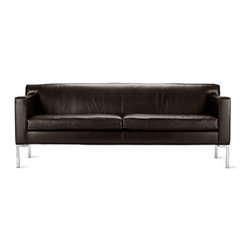 Theatre Sofa - Modern sofas often tout minimalist appeal, but few can also claim the comfort of Ted Boerner's Theatre Sofa, Two-Seater Sofa and Armchair (2001). Designed to accommodate the human body with studied proportions and simple geometry, the set's comfort stems from its form rather than excessive layers of stuffing and upholstery. The gentle angling of the backrest, full seat depth and elevated armrests are eminently suited to a formal living room or reception area. Boerner's signature artisan details are evident throughout these handcrafted pieces; welted seams lend strength and definition to the supple, full-grain Italian leather or high-quality fabric upholstery. A gleaming chromed steel base that runs the entire depth of the design. Made in U.S.A.