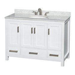 Wyndham Collection - Wyndham Collection WCS141448SWH Sheffield 48-in. Single Bathroom Vanity - White - Shop for Bathroom Cabinets from Hayneedle.com! The elegant simplicity of the Wyndham Collection WCS141448SWH Sheffield 48-in. Single Bathroom Vanity - White is going to be the perfect starting point for your bathroom remodel. The clean-lined body of this cabinet is as complementary to modern styles as it is to environments with a more classic feel. The elegant and casual style of this wide single-sink vanity starts with a cabinet of solid wood that's put through a 12-step preparation and finishing process that results in a clean white finish that's environmentally friendly and low in VOCs. Four doors open to reveal three open storage compartments and three pull-out drawers offer further storage. Each deeply doweled drawer slides on fully extendable metal glides so you can use every inch of interior storage. The drawers and doors all feature self-closing soft-touch latches. A full range of material and color options let you customize the vanity top and undermount sink to your personal tastes. You even have the option of not purchasing either leaving you open to do some serious customizing on your own.Product Dimensions:Vanity dimensions with top: 48W x 22D x 35H in. About the Wyndham CollectionWyndham and the Wyndham collection are all about refinement detailing uniqueness quality and longevity. They are dedicated to the quality of their products and own the factory where each piece is constructed. This allows Wyndham to offer products that reflect the rigorous quality standards required for every piece that is offered to their customers. The Wyndham collection showcases elegant modern design styles that highlight functionality and style in every detail.