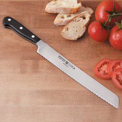 None - Wusthof 4150 Classic 9-inch Bread Knife - The pronounced serration of this knife's blade is ideal for cutting through tough crusts without undue pressure. The knife's length and triangular tip make it perfect for slicing both long and round loaves.