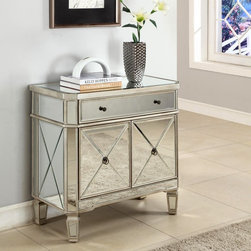Powell - Powell Mirrored 2 Door Console - 233-228 Multicolor - 233-228 - Shop for Buffets and Side Boards from Hayneedle.com! You might not think of storage pieces as centerpieces but you will when you see the Powell Mirrored 2 Door Console - 233-228. Crafted with durable solid and engineered wood this traditionally styled console is generously topped with clear beveled mirrored glass panels that add instant glamour to both the console itself and the space in which it stands. Notched corners and shaped feet are framed in pale grey-finished wood and artful cross-bracing adds dimension to the console's side and two front doors which open to a cabinet space. Above a narrow storage drawer is outfitted with dual knobs. It's perfect for jewelry delicates stationary keepsakes - all the must-haves in any lady's room.More About Powell FurnitureBased in Culver City Calif. the Powell company designs imports and distributes occasional dining accent and youth furniture across all style categories. Since 1968 Powell has grown to become one of the most recognized names in the home furniture industry. From sturdy safe childrens furniture to elegant bedroom and other home collections Powell continues to develop new and exciting designs for homes around the globe.