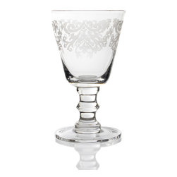 France Engraved Footed Glass- Large - Rendered in the translucent white of frosted glass against a backdrop of whatever liquid you please, the patterns etched into the France Engraved Footed Glass elevate substantial stemware already a luxury addition to the table to a more artful level. This elegant goblet, the larger of two size choices, contributes to a convivial mood around the table when you use it for sparkling water or sweet iced tea.