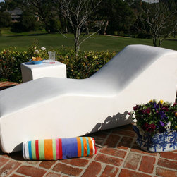 Wave Chaise - I love the idea of placing this chaise poolside with colorful pillows. Its elegant form is solid and striking and colorful pillows would make the piece even more eye catching.