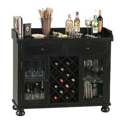 Howard Miller - Black Farmhouse Wood Home Bar with Wine Rack - This distinctive Locking Bar & Liquor Storage Cabinet displays appealing decorative features that will enhance any upscale room setting! The 41 inch high cabinet is finished in Worn Black and offers a central wine rack with a 14 bottle capacity. From its quaint bun feet to its Worn Black finish to resemble a darling antiquity appearance, this console liquor cabinet is a Howard Miller design. Its center wine rack holds up to fourteen bottles, while its adjustable shelves will easily hold all that you desire for beverages. Two dove-tailed drawers store accessories while the lockable wood wine rack stores up to 14 wine bottles. * A decorative apron surrounds the serving area on three sides, and bun feet create a pleasing accent on the baseThe two drawers feature quality details such as dove-tailed construction and metal drawer guidesA center wood wine rack holds up to 14 bottlesStemware, glasses, spirits, and bartender's guides can be neatly tucked away on the adjustable shelvesFinished in Worn Black on select materials, hardwoods and veneersAdjustable levelers under each corner provide stability on uneven and carpeted floorsLocking door for added security. No Assembly Required48 in. W x 17 in. D x 41 in. H (185 lbs.)