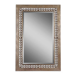Uttermost - Fidda Antique Silver Mirror - This mirror is not shy. It wants to be the focal point in your room. The hand-forged metal frame is finished in antique silver leaf with black undertones adding depth and texture. The open beading allows the wall's texture to shine through, adding yet another element.