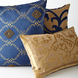 """Sultana Pllows - Rich color, luxe fabric, and exotic patterns make these pillows the perfect choice for breathing new life into a room. Oblong pillow (shown in front) made of silk/cotton; 22"""""""" x 14"""""""". Tile-pattern pillow (shown in middle) made of silk/cotton; 20""""""""Sq. Medallion pillow (shown in back) made of cotton/viscose; 22""""""""Sq."""