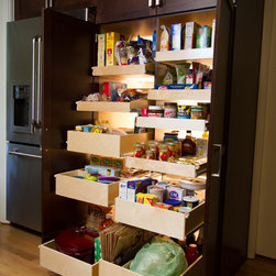 Custom Slide Out Pantry Shelves - Create the ideal kitchen storage with a custom pantry makeover from ShelfGenie of Philadelphia.  We custom design, build and install pull out shelves for your existing cabinet or closet pantry.  This pantry features a mixture of single-height shelves, double-height shelves and triple-height pull out shelves with sloped and straight sides.  The upper righthand side of the pantry also features our tray dividers, ideal for storing baking pans and cutting boards.