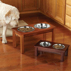 Elevated Wooden Feeder - An elevated wood dog feeder is a pretty nice addition for your home, and your dog will love it, especially if he's on the older side.