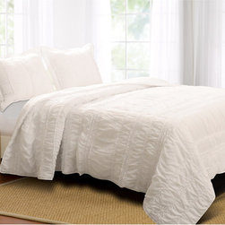 None - Tiana Country White 3-piece Quilt Set - Elegant and sophisticated,this romantic bedding set combines both ruffles and ruching. Oversized for better coverage on today's deeper mattresses this convenient and stylish set is prewashed and preshrunk.