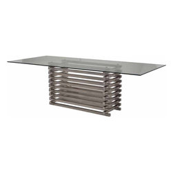 Nuevo Living - Stacked Dining Table - For something built out of heavy metal, this large dining table has a surprisingly sleek and unobtrusive design. The base of stacked stainless steel bars gives it a strong, industrial edge that's balanced by a glass top so light and clear, you'd never guess it's spacious enough to seat eight. With its clean modern lines and lustrous shine, this table will add style and character to any modern dining room.