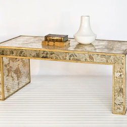 Worlds Away Reverse Mirror Coffee Table Gold Leaf - While we still love chrome, nickel and silver, brass and silver are back in a BIG way these days. This mirrored and gold leaf coffee table is the perfect way to bring some big bravura modern style into your home.