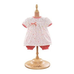 Corolle Mon Classiques Bebe 17 in. Bloomer Happiness Doll Ensemble - Dressed in the Corolle Mon Classiques Bebe 17 in. Bloomer Happiness Doll Ensemble her Corolle Mon Bebe Classiques dolly will be cute and ready for the day. This beautifully sewn and artfully finished ensemble includes a white flower-print dress and super-cute coordinating pink bloomers. This outfit is designed to fit her 17-inch doll.About CorolleCorolle is a premier doll brand designed in the storybook region of France's Loire Valley. Since 1979, Corolle has been creating highly detailed dolls designed to be cherished by children everywhere. Every Corolle doll will inspire magical childhood memories that will last for a lifetime. Corolle dolls look and feel as real as possible. They're created of soft, supple vinyl, have natural-looking hair, and wear on-trend fashions. Corolle dolls are designed durable enough to withstand years of hugs and love. Perfect heirloom treasures! Doll play encourages children to explore different roles from caring for and sharing hopes and dreams to finding an understanding playmate and friend for life. Corolle designs dolls for children of all ages.There is a range of Corolle dolls designed for specific ages. Babi Corolle is a soft-body doll perfect for newborn babies and older. It's machine-washable, feather-light, and made to be loved. Mon Premier Corolle is designed for babies 18 months and older. This line includes a range of baby dolls, clothing, and accessories. The dolls are lightweight and soft. The clothing has Velcro closures so it's easy to put on and take off. Mon Classique Corolle is a classic baby doll designed for toddlers to love and nurture. This line has a complete assortment of larger baby dolls, clothing, and nursery accessories. Some even have hair that can be brushed and styled. Others coo, giggle, drink, and go potty. Mademoiselle Corolle is a toddler doll for toddlers. These dolls have expressive faces, silky long hair, and are dressed in the latest styles. This doll will be your little one's best friend. She's perfect for sharing secrets and working out new hairstyles and fashion. Les Cheries Corolle is designed for little ones four years and older. She has long, lush, rooted hair and an amazing wardrobe of stylish outfits. This doll provides endless hours of fashion and hair play.