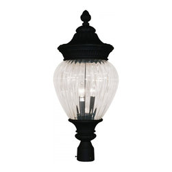 Three Light Black Clear Ribbed Optic Glass Post Light - Sophisticated and classic, this large outdoor post head is a truly elegant piece. Comprised of cast aluminum (which can endure all seasons), this fixture uses clear beveled glass a combination with a fixture that is highly detailed and finished in black, to create a tribute to classic elegance. Select parts of this fixture are hand cast in order to ensure the overall strength of this wonderful fixture.