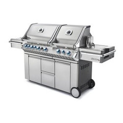 Napoleon Prestige PRO825 Grill with Infrared Rear and Side Burners - The Napoleon Prestige PRO825 Grill with Infrared Rear and Side Burners make a great gift for Father's Day birthdays and more. Option to choose propane or natural gas fuel type. The main grill surface comes with 837 square inches of cooking space featuring an infrared rear burner for slow-roasting (a rotisserie kit is included) featuring a total of 123 000 BTUs of cooking heat. A roll-top lid is easy to lift and helps retain heat for efficient cooking. Provide the meat with rich smoky flavor thanks to an integrated wood-chip smoker tray. A bucket is built into the grill providing a handy place for marinades and ice. Slide dice chop and mince meat vegetables and fruit right by the grill for the freshest ingredients possible. Each of the stainless steel wave-shaped tube burners is individually ignited by JetFire buttons. Built-in halogen lights and Night-Light backlit knobs make cooking at night a fun adventurous alternative. The double-door cabinet built into the base features storage shelves accessory hooks and more. You'll find this grill perfect for everything from burgers brats roasted vegetables and more. About Napoleon Napoleon got its start in 1976 as a steel fabrication business launched by Wolfgang Schroeter in Barrie Ontario Canada. Solid cast iron two-door stoves became a single glass door model with Pyroceram high-temperature ceramic glass. In 1981 the name Napoleon was coined for their items. Over the years Napoleon has led the way with innovative engineering and design. They are now North America's largest privately owned manufacturer of quality wood and gas fireplaces gourmet gas and charcoal grills outdoor living products and heating and cooling products.