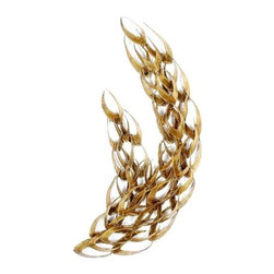 Pre-owned Mid-Century Brutalist Wave Wall Sculpture - A brutalist mid-century modern metal wall sculpture in the style of C Jere. Beautiful gold colored hue to the torch cut metal. A series of leaf life shapes join to create a mass mimicking the essence of a wave or a tree branch blowing in the wind. Even though static, the sculpture truly feels appears to be in motion. Hang horizontally or vertically.
