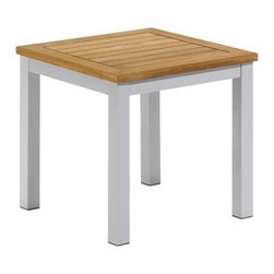Oxford Garden Travira Teak End Table - No matter how stylish your patio seating area is, it's really not complete until you have a place to set your iced tea. That's where the Oxford Garden Travira End Table comes in. Featuring a strong aluminum frame, this table has a light grey metallic powder-coated finish to keep it well-preserved. A teak wood, slatted table top softens the overall look and creates an eye-catching combination of materials.About Oxford GardenProducing shorea wood furniture since 1997, Oxford Garden has always offered exceptional value for outdoor living. Located in Louisville, Ky., and family operated, Oxford Garden's goal is to provide quality furniture for the outdoors while remaining reasonably priced. Every piece of furniture is commercial grade, handcrafted of shorea hard wood, and uses mortise-and-tenon joinery for superior strength. Oxford Garden is known for creating outdoor furniture with a classic, timeless style.