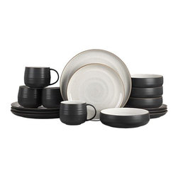 """18th St. 16-Piece Dinnerware Set - Modern and restrained in form, expressive and rustic in glaze. The artisan's hand is authentically reproduced in this stoneware pattern designed exclusively for Crate and Barrel by ceramic artist and designer Kathy Erteman at her 18th Street studio in New York City. A contemporary matte black exterior contrasts the rustic beauty of a shiny, speckled white glazed interior ringed with the subtly raised spiral associated with hand-thrown pieces. A raised clay rim features a sandy glaze that evokes the feel of exposed terra cotta. To capture the artisan look of this dinnerware, Erteman modeled prototypes to true scale by hand with her original glazes as reference for production. In the words of the designer, """"When making tableware, I consider design and the rigors of daily use. The spirit of my hand in these pieces is modest, to harmonize with and act as a support to the prepared ingredients."""""""