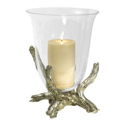 Silver Branch Hurricane - A goblet of clear glass rests in a fork of detailed twigs, creating the asymmetry and substance of the Silver Branch Hurricane. Realistically textured with bark, the metallic base of this mood-lighting essential sets the tone for a woodland allusion in updated transitional silver. A flaring lip to the glass candle cup makes it appear to float where it balances amidst the wood.