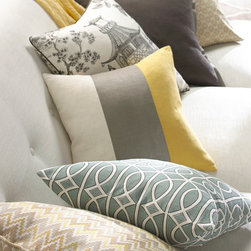 Pillows - Infuse modern style into any room with an assortment of custom decorative throw pillows. Putty grey and mustard yellow embroidered chevron, grey and white trellis, slate grey and yellow colorblock, black and white toile chinoiserie, and dark pebble grey velvet pillows create an eclectic layered look.