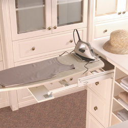Pull Out Ironing Board - Every household needs an ironing board but it's storage is often difficult and can take up valuable space. Eliminate this problem with a built-in board. Hidden within a drawer, this board pulls out, opens and secures to give you a perfect ironing surface without wasting space. An excellent feature to add to a laundry room, mudroom or even office or master closet.