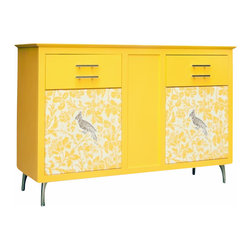 Morgann Paull - Isadora Media Center, Princess White - This elegant and bold entertainment center, shown in yellow, with a parrot nested in a floral design is what we describe at Morgann Paull as elegant funk. Clearly an alternative to traditional entertainment centers, with rich color and texture.