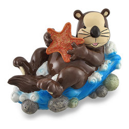 Zeckos - Whimsical Sea Otter and Starfish Coin Bank Piggy Bank - This oh-so-adorable coin bank is a fun accent in any child's room and features a whimsical sea otter holding a glittering starfish, relaxing on a wave sure to delight your little one while encouraging a healthy saving habit Made of cast resin with a glossy hand-painted finish, it measures 6.25 inches (16 cm) high, 5.75 inches (14 cm) wide, 10 inches (25 cm) long, and easily empties via a plastic twist-off plug in the bottom for deposit into a savings account. This whimsical sea otter coin bank is a wonderful birthday, holiday or anytime gift sure to be enjoyed