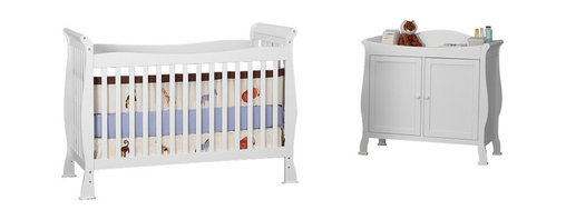 Da Vinci - DaVinci Reagan 4-in-1 Convertible Wood Crib Set w/ Toddler Rail in White - Da Vinci - Baby Crib Sets - M2801WK5152Wpkg -  DaVinci Parker 2-Door Wood Baby Changer in White (included quantity: 1) Change baby safely with this Parker changer. Engineered for convenient storage, don't pass up the Parker. This beautifully crafted two-door changing table adds a whimsical touch to your baby's nursery. The changer top is equipped with a baby-friendly safety strap, while the glide-system metal hinges allow for easy and smooth motion when opening and closing cabinet doors for easy access to baby care essentials.