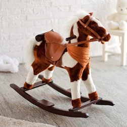 Charm Pinto Plush Rocking Horse with Sound - The Pinto Rocking Horse with Sound is much more than just a rocker. It's your child's companion ready to enter a world of magical adventures. Seated on the horse's comfortable saddle gently rocked by its soothing motion he is sure to feel like a prince. To top it all the soft plush black-white rocker looks and feels every bit like a real horse with its spirited neighing and galloping sounds. The Pinto Rocking Horse takes two AA batteries which are not included. Extra features include saddle saddle blanket bedroll and neckerchief. The base of this horse is made from high-quality Chinese pine which ensures stability and an even rocking movement. And if the going gets tough while fighting off a fire-breathing dragon your hero can always hold onto the wooden grip bars for extra support. With the Pinto Horse your hero will always be a winner. Order one for him right away. Recommended for children 3-6 years. Dimensions: 30L x 12W x 26H inches. About Charm Co.Charm Company is the nation's leader in battery powered and motion toys. Their standards of quality in terms of safety and performance are second to none and its special relationship with its customers proves it. The high-end catalog and department store toy market has consistently made Charm Company a success and now their themed products can be seen in hotels theme parks and gift shops all over the nation.
