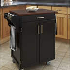 "Home Styles - Kitchen Cart - Home Styles Cuisine Kitchen Cart with a .75"" finished top features solid wood construction. Features: -Two cabinet doors open to storage with adjustable shelves inside.-Handy spice rack, towel bar.-Heavy duty locking rubber casters for easy mobility and safety.-Product Type: Kitchen Cart.-Collection: Cuisine Cart.-Counter Finish: Cherry wood.-Hardware Finish: Brushed Steel.-Distressed: No.-Powder Coated Finish: No.-Gloss Finish: No.-Base Material: Wood.-Counter Material: Cherry wood.-Hardware Material: Brushed steel.-Solid Wood Construction: Yes.-Number of Items Included: 1.-Water Resistant or Waterproof Cushions: No.-Stain Resistant: No.-Warp Resistant: No.-Exterior Shelves: No.-Drawers Included: Yes -Number of Drawers: 1.-Push Through Drawer: No..-Cabinets Included: Yes -Number of Cabinets : 1.-Double Sided Cabinet: No.-Adjustable Interior Shelves: Yes.-Number of Doors: 2.-Locking Doors: No.-Door Handle Design: Linear pulls..-Towel Rack: Yes -Removable Towel Rack: No..-Pot Rack: No.-Spice Rack: Yes .-Cutting Board: No.-Drop Leaf: No.-Drain Groove: No.-Trash Bin Compartment: No.-Stools Included: No.-Casters: Yes -Locking Casters: Yes.-Removable Casters: No..-Wine Rack: No.-Stemware Rack: No.-Cart Handles: No.-Finished Back: Yes.-Commercial Use: No.-Recycled Content: No.-Eco-Friendly: No.-Product Care: Clean with a damp cloth.Specifications: -ISTA 3A Certified: Yes.Dimensions: -Overall Height - Top to Bottom: 35.5"".-Overall Width - Side to Side: 32.5"".-Overall Depth - Front to Back: 18.75"".-Width Without Side Attachments: 27.25"".-Height Without Casters: 31.75"".-Countertop Thickness: 0.75"".-Countertop Width - Side to Side: 27.25"".-Countertop Depth - Front to Back: 18.75"".-Shelving: -Shelf Width - Side to Side: 23.25"".-Shelf Depth - Front to Back: 14.75""..-Leaf: No.-Drawer: -Drawer Interior Height - Top to Bottom: 1.5"".-Drawer Interior Width - Side to Side: 20.25"".-Drawer Interior Depth - Front to Back: 13.25""..-Cabinet: -Cabinet Interior Height - Top to Bottom: 23.5"".-Cabinet Interior Width - Side to Side: 23.25"".-Cabinet Interior Depth - Front to Back: 14.75""..-Overall Product Weight: 73 lbs.Assembly: -Assembly Required: Yes.-Tools Needed: Phillips screwdriver.-Additional Parts Required: No.Warranty: -Product Warranty: Vendor replaces parts for 30 days."