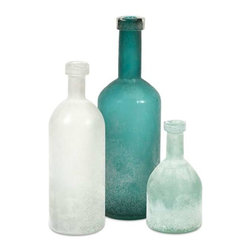 Russell Hand - Blown Glass Bottles - Set 3 - This set of three hand-blown glass bottles each feature a frosted appearance and look beautiful in a variety of settings. With rich shades of aqua, soft blue and white, this collection is a must have for any decor.