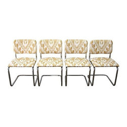 "Pre-owned Ikat Cantilevered Chrome Chairs - Set of 4 - A newly reupholstered set of four chrome cantilevered chairs. Linen blend tan and white ikat patterned fabric. Chrome frames are in excellent shape, no wear or signs of rust. Seat, 18.25""H; back, 32.75""H."