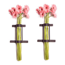 Danya B. - Set of 2 Wall Mount Cylinder Glass Vases with Rustic Rings Metal Stand - Free up your table space by hanging your flowers aloft, with these rustic metal-mounted vase on your wall. This innovative design was expertly crafted from recycled glass and sturdy iron. This set of two wall sconce vases would work well flanking your sideboard, or outside on the patio.