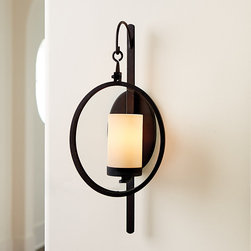 Ballard Designs - Orsin Wall Sconce - Evoking vintage industrial design of the 20th-century, our Orsin Wall Sconce has simple lines, exposed hardware and a mottled charcoal finish. A suspended round glass panel fronts the cream glass shade.