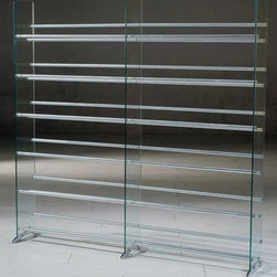"""Transdeco - Deco Multimedia Storage Rack - This sleek & contemporary designed glass multimedia rack compliments any room decor. Display your CD/DVD collections in a very unique way. Features: -RTA design.-Clear tempered safety glass panels with beveled edges.-12 fixed metal rod shelves.-Stylish metal feet for stability.-DVD or CD title faces up for easy viewing.-Commercial Use: Yes.-Material: Glass & Metal.-Distressed: No.-Collection: Deco Storage.-Wall Mountable: No.Dimensions: -Overall Height - Top to Bottom: 55.25"""".-Overall Width - Side to Side: 56.125"""".-Overall Depth - Front to Back: 11"""".-Overall Product Weight: 45 lbs.Assembly: -Assembly Required: Yes.Warranty: -2-year limited warranty.-Product Warranty: 1 year."""