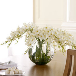 "John-Richard Collection - John-Richard Collection ""Ivory Cascade"" Faux Floral - Pale Dendrobium orchids seem to spill from a clear glass globe in this beautiful faux arrangement from the John-Richard Collection. Stems are secured in clear acrylic ""water."" Arrangement is approximately 33""Dia. x 17""T; glass vase is 12""Dia. x 10""T. Im..."