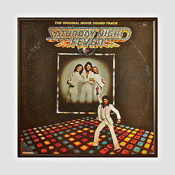 """Glittered Saturday Night Fever Album - Glittered record album. Album is framed in a black 12x12"""" square frame with front and back cover and clips holding the record in place on the back. Album covers are original vintage covers."""