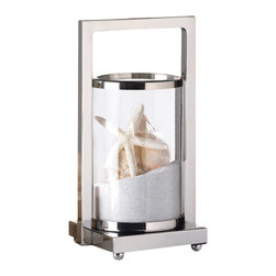 Malibu Creations - Malibu Creations Modern Mariner Candle Lantern - You don't have to be a salty seafarer to appreciate the contemporary brilliance of this candle lantern. The sleek sliver framework features geometric angles that give this accent a current-yet-classic vibe. You can navigate your way to stunning decor by placing this stainless steel and glass candle holder on your tabletop, mantel, and beyond. Fill it with the pillar candle of your choice for a shining example of your great taste, or get creative and fill it with sand from the shore, seashells, or treasures you've collected on your journeys across the globe.