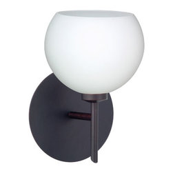 Besa Lighting - Palla Opal Matte Bronze Sconce - - The Palla 5 pendant features a diminutive orb-shaped glass, that complements any aesthetic. Our Opal glass is a soft white cased glass that can suit any classic or modern decor. Opal has a very tranquil glow that is pleasing in appearance. The smooth satin finish on the clear outer layer is a result of an extensive etching process. This blown glass is handcrafted by a skilled artisan, utilizing century-old techniques passed down from generation to generation. The mini sconce is equipped with a decorative lamp holder mounted to either a low profile round or square canopy. These stylish and functional luminaries are offered in a beautiful brushed Bronze finish.  - Bulbs included: Yes  - Canopy/Fitter Height: 5-inches  - Canopy/Fitter Diameter/Width: 5-inches  - Height from center: 5.25  - : NOTICE: Due to the artistic nature of art glass, each piece is uniquely beautiful and may all differ slightly if ordering in multiples. Some glass decors may have a different appearance when illuminated. Many of our glasses are handmade and will have variances in their decors. Color, patterning, air bubbles and vibrancy of the d�cor may also appear differently when the fixture is lit and unlit. Besa Lighting - 1SW-565807-BR