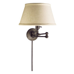Boston Swing Arm Lamp - Paradigm shift: Your original vision involved a good looking traditional wall lamp for ambient lighting. But now your thinking has changed: You need focused lighting for reading and desk work. This swing arm lamp can accommodate both concepts by extending or contracting, as need demands.