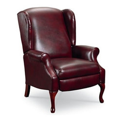 Makenzie Leather Recliner Chair - Shhh, don' tell anyone.  This classic, elegant wingback chair is actually a recliner.  The Makenzie recliner is the best of both worlds...sophisticated styling with down home comfort.